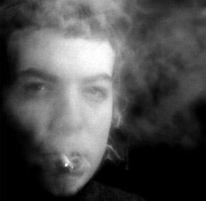 Woman's face, smoking (monochrome)