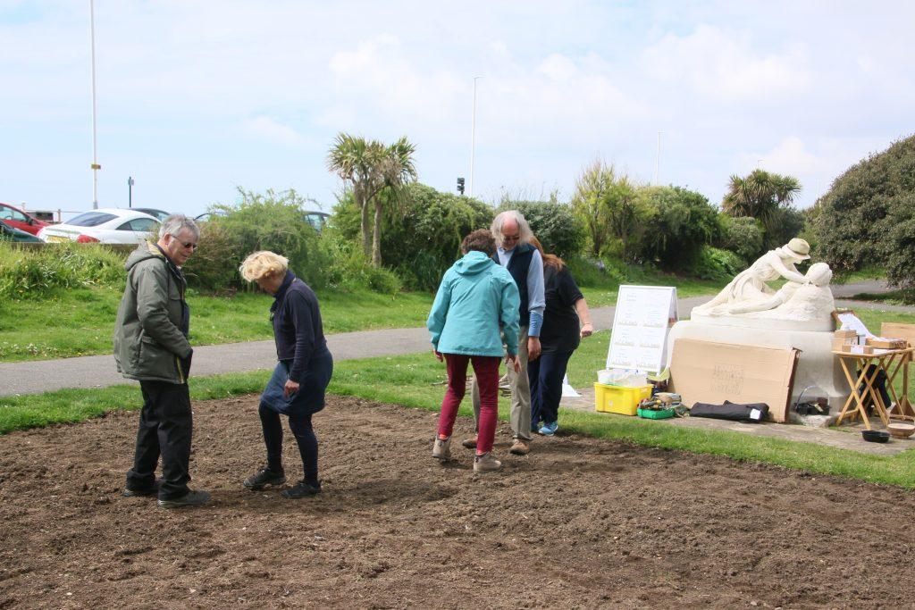 founr people treading on bare soil